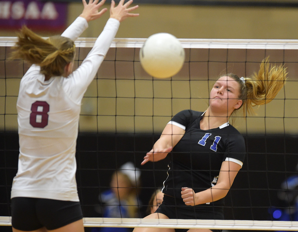 . Longmont\'s Rachel Kusbel spikes the ball past Silver Creek\'s Katie James in the first game at Silver Creek High School Thursday night. To view more photos visit bocopreps.com. Lewis Geyer/Staff Photographer Oct. 19, 62017