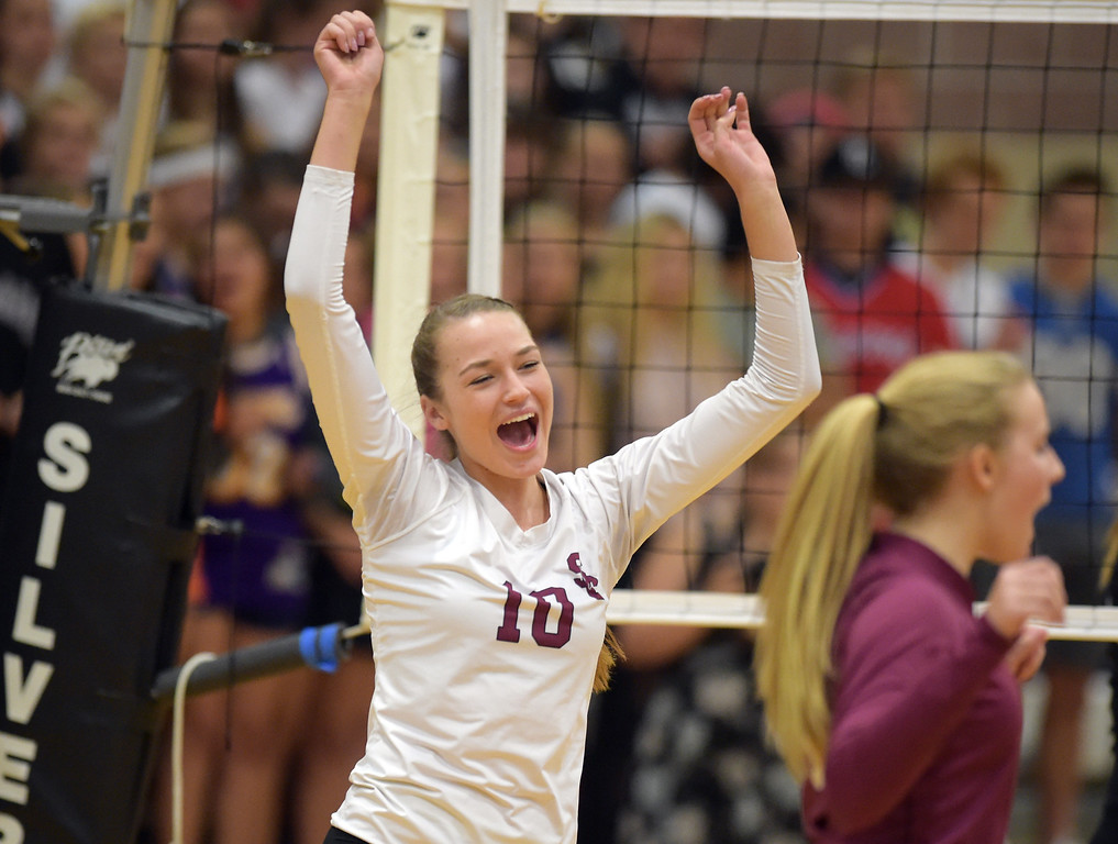 . Silver Creek\'s Caitlin Volkmann celebrates a point scored against Longmont in the first game at Silver Creek High School Thursday night. To view more photos visit bocopreps.com. Lewis Geyer/Staff Photographer Oct. 19, 62017