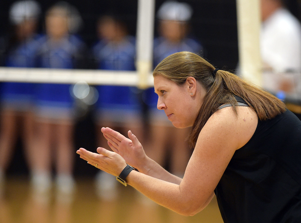 . Silver Creek coach Tatum McKenzie encourages her team during the first game against Longmont at Silver Creek High School Thursday night. To view more photos visit bocopreps.com. Lewis Geyer/Staff Photographer Oct. 19, 62017