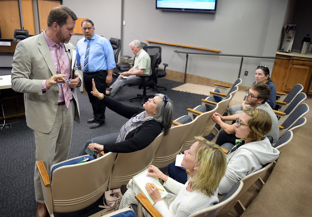 . Mayor Brian Bagley talks with audience members during an intermission at the Longmont city council public forum Tuesday night. To view more photos visit timescall.com. Lewis Geyer/Staff Photographer May 15, 2018