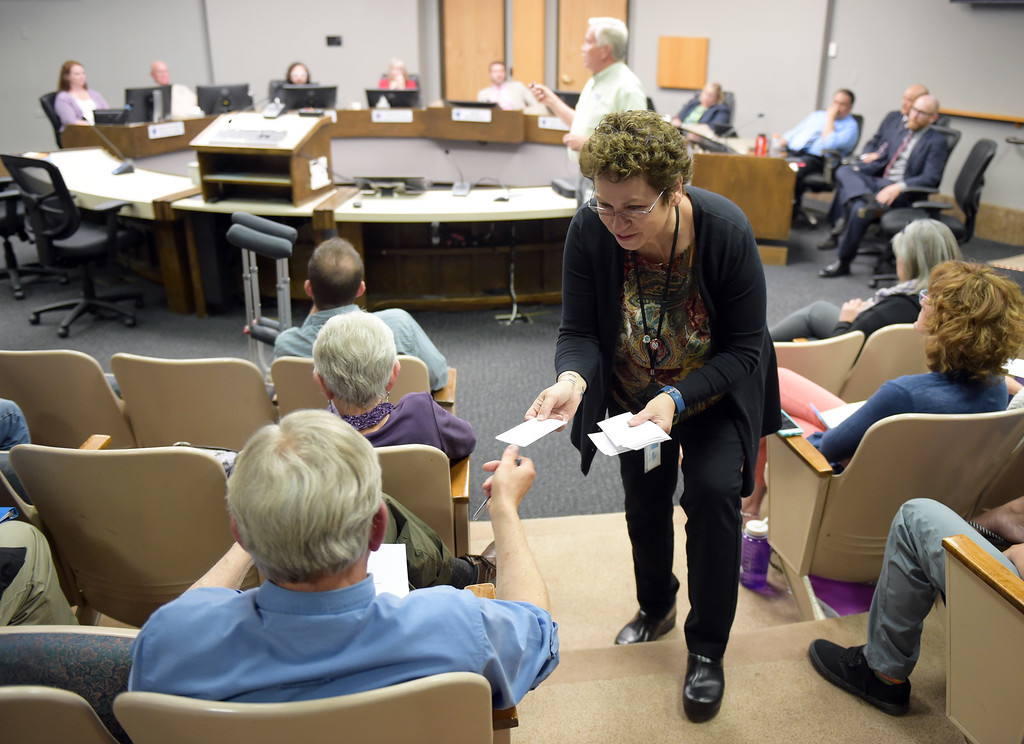 . City IT employee Susan Wolak collects written questions from an audience member during the Longmont city council public forum Tuesday night. To view more photos visit timescall.com. Lewis Geyer/Staff Photographer May 15, 2018