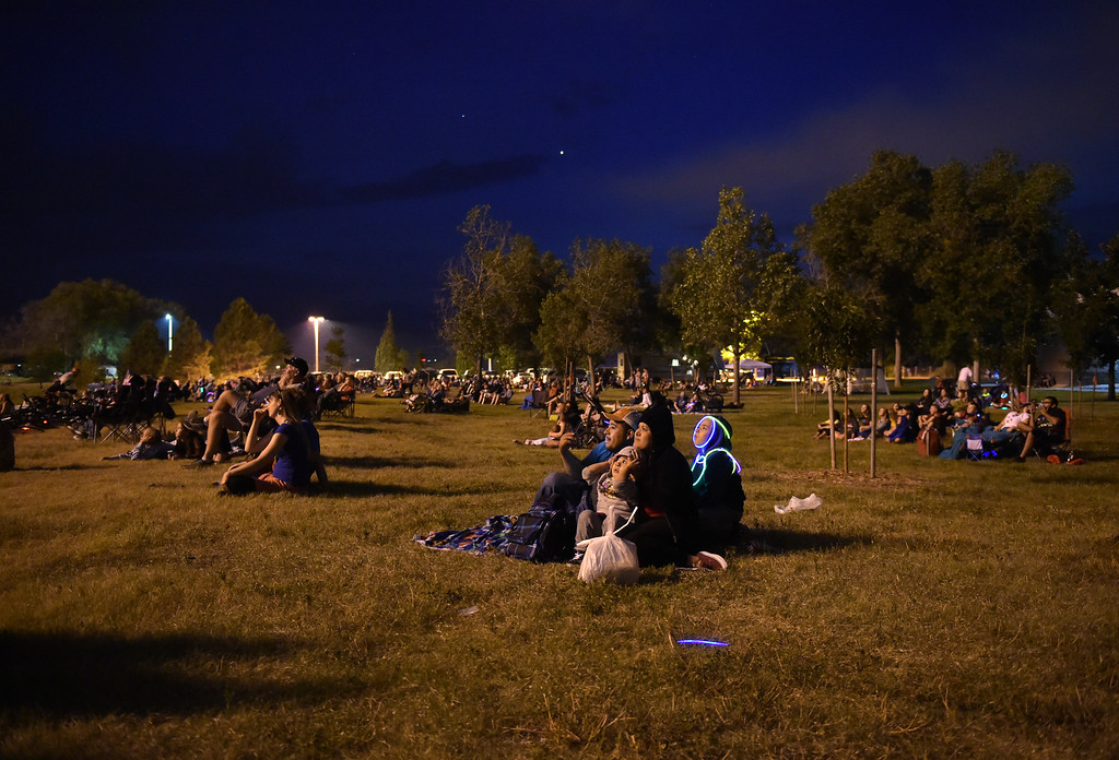 . The crowd watches as fireworks are shot off from the south side of Rogers Grove in celebration of the Fourth of July Wednesday evening. Lewis Geyer/Staff Photographer July 04, 2018