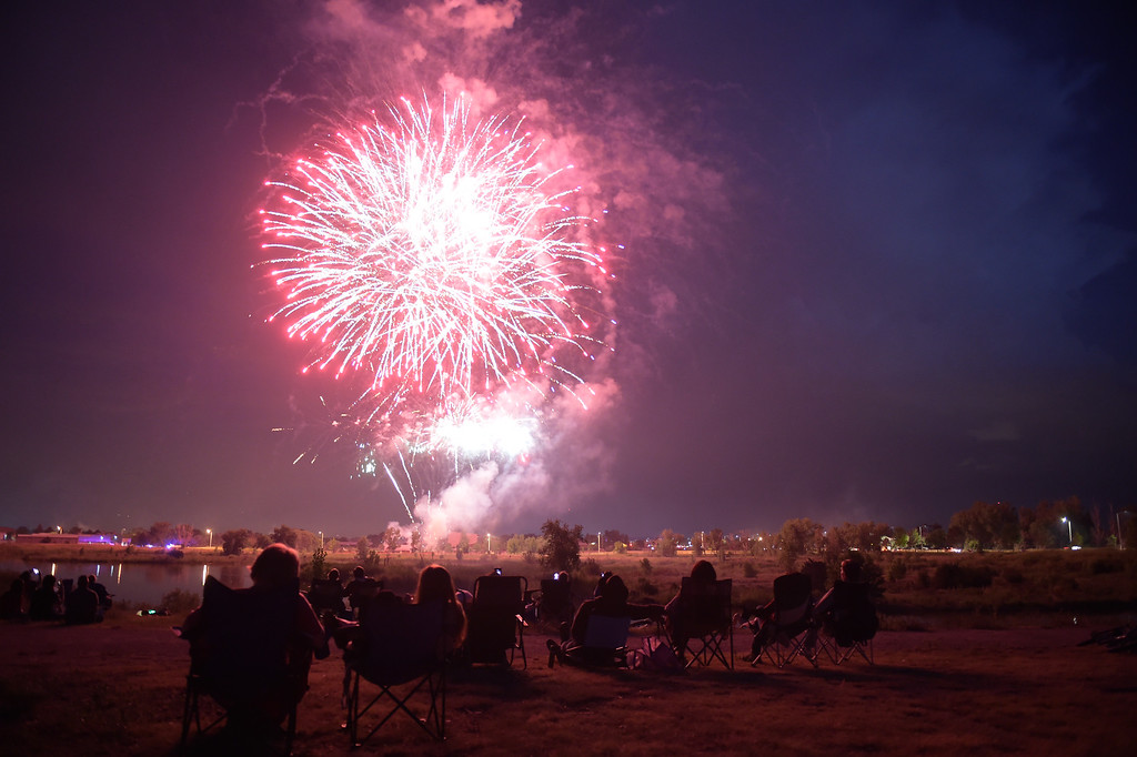 . Fireworks are shot off from the south side of Rogers Grove in celebration of the Fourth of July Wednesday evening. Lewis Geyer/Staff Photographer July 04, 2018