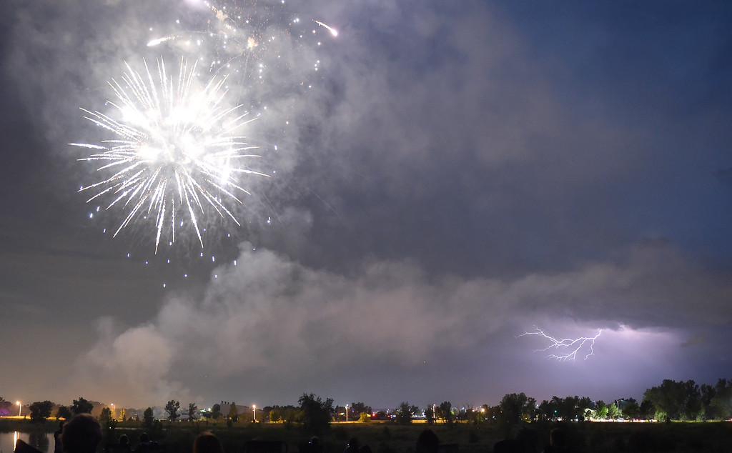 . Lightning appears in the sky southwest of Longmont during the Fourth of July fireworks show in Rogers Grove Wednesday evening. Lewis Geyer/Staff Photographer July 04, 2018