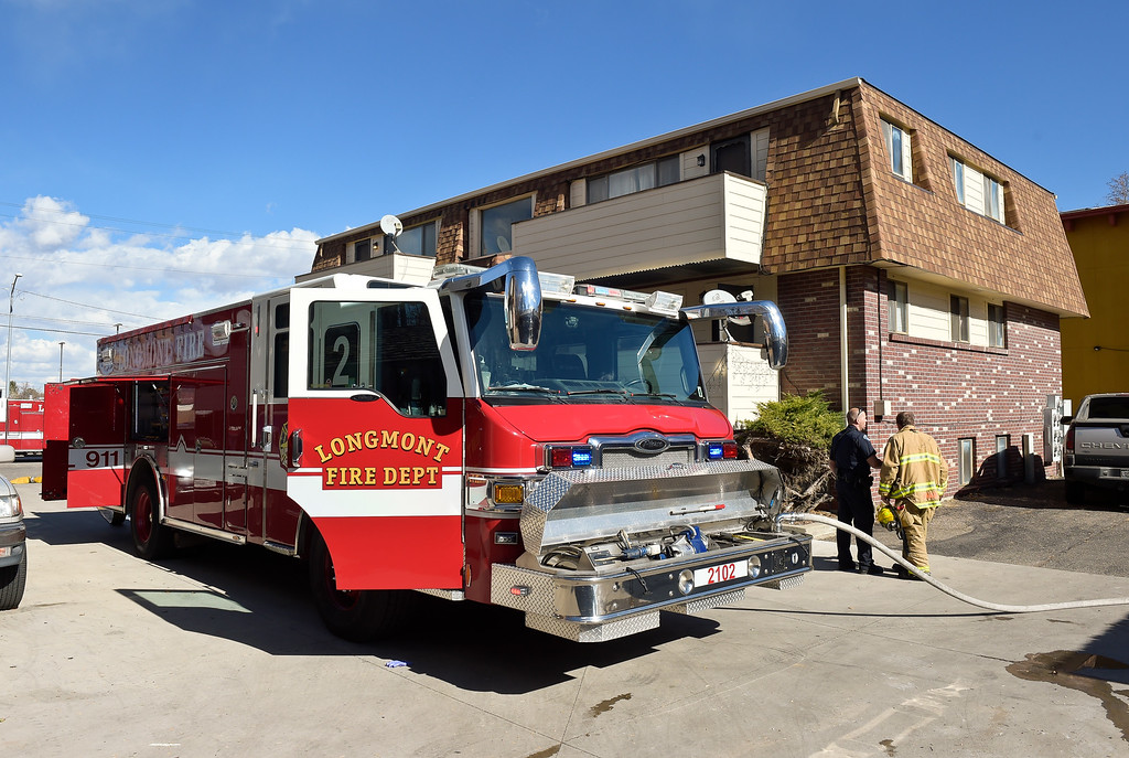. LONGMONT, CO - NOVEMBER 6: Station 2\'s fire engine is parked adjacent to the apartment building to battle a fire between two multi-car garages behind the apartment building at 1611 Warren Ave., Nov. 6, 2018. (Photo by Lewis Geyer/Staff Photographer)