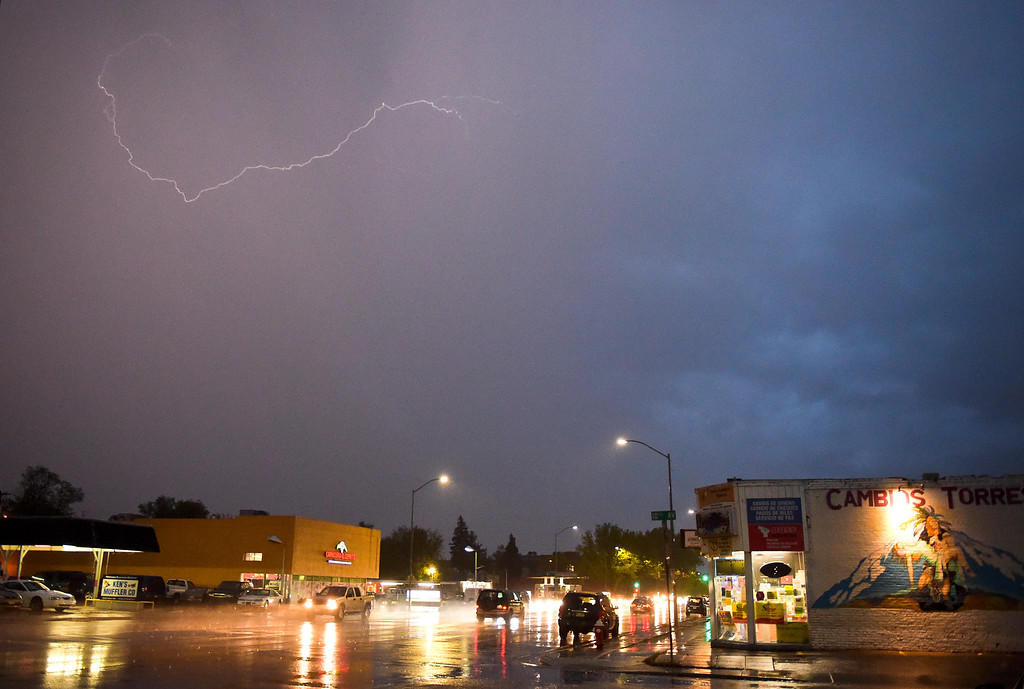 . Lightning appears in the sky over Longmont as heavy rain and thunderstorms passed through the area Sunday night. To view more photos visit timescall.com. Lewis Geyer/Staff Photographer May 13, 2018