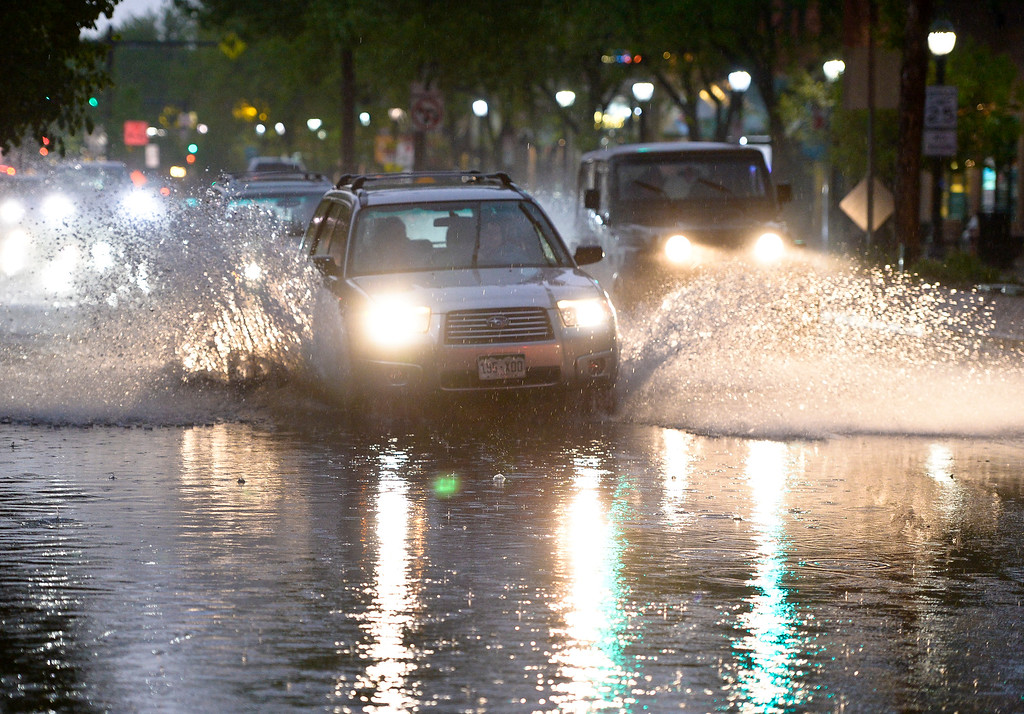 . Traffic goes through a flooded portion of Main Street, at Fourth Avenue, during periods of heavy rain and thunderstorms passing through the Longmont area Sunday night. To view more photos visit timescall.com. Lewis Geyer/Staff Photographer May 13, 2018