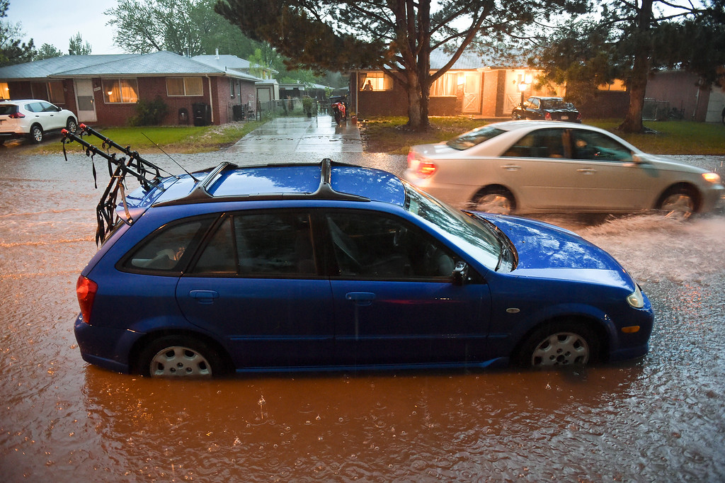 . A car parked on Collyer Street, near Emery Drive, is surrounded by water during periods of heavy rain and thunderstorms passing through the Longmont area Sunday night. To view more photos visit timescall.com. Lewis Geyer/Staff Photographer May 13, 2018