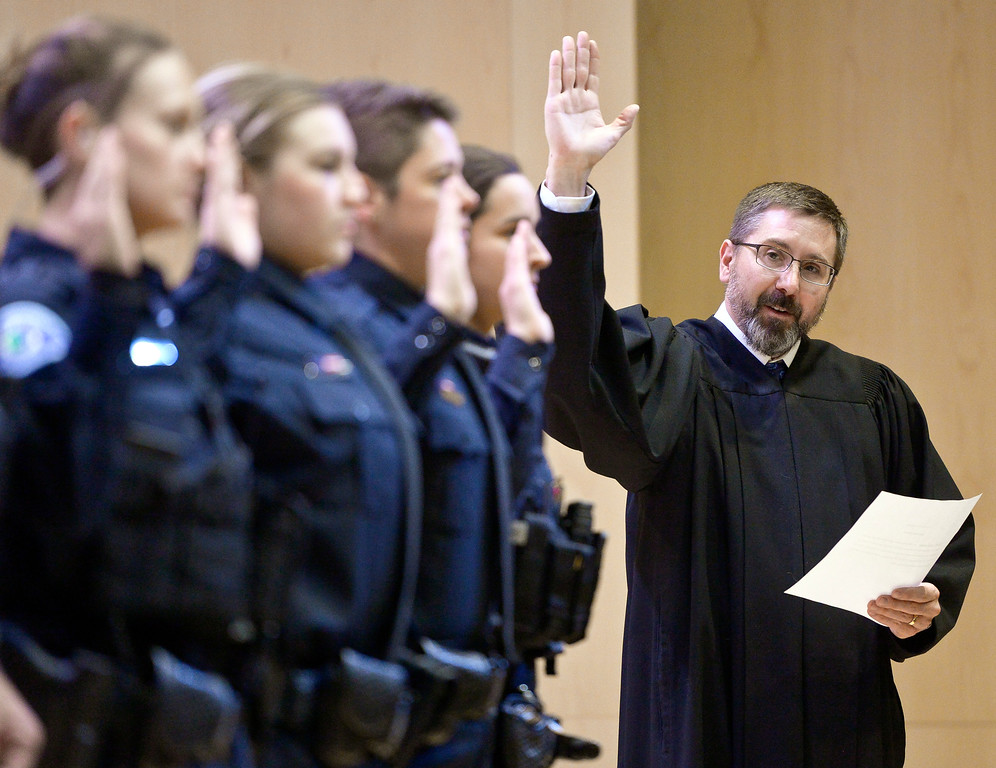 . LONGMONT, CO - JANUARY 14: Ten new Longmont police officers are sworn in by municipal judge Robert Frick during the Public Safety Recognition Ceremony January 14, 2019 in the Stewart Auditorium at the Longmont Museum and Cultural Center. To view more photos visit timescall.com. (Photo by Lewis Geyer/Staff Photographer)