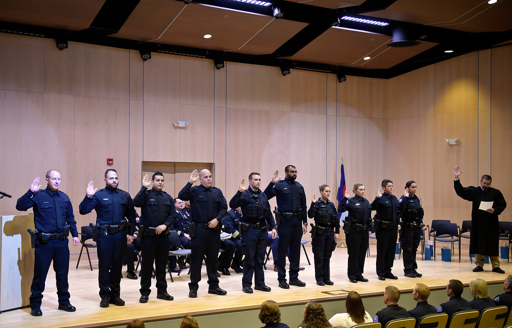 . LONGMONT, CO - JANUARY 14: Ten new Longmont police officers are sworn in by municipal judge Robert Frick, right, during the Public Safety Recognition Ceremony January 14, 2019 in the Stewart Auditorium at the Longmont Museum and Cultural Center. (Photo by Lewis Geyer/Staff Photographer)