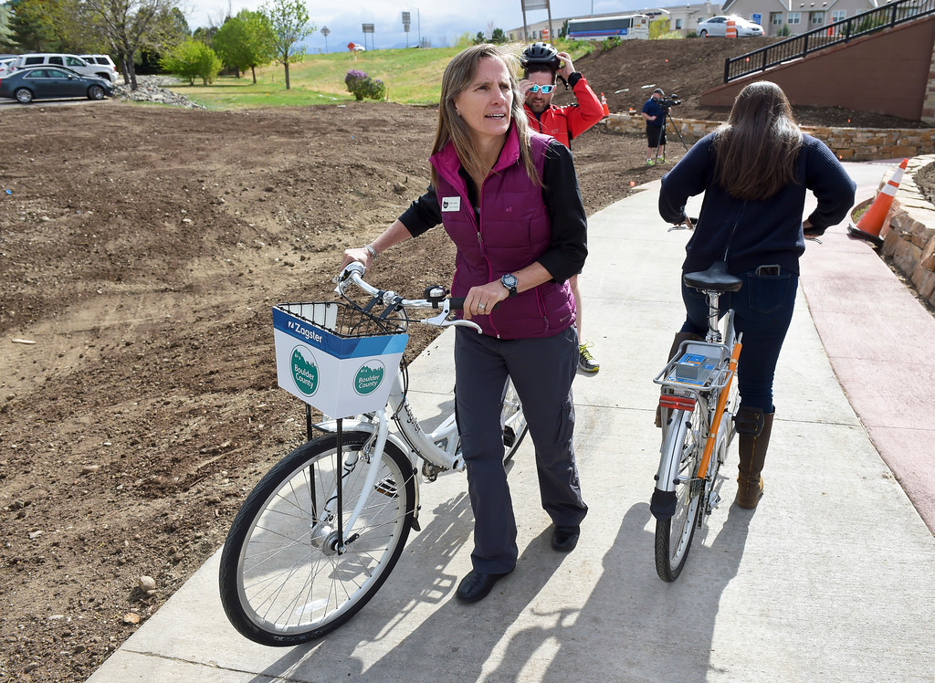 . Boulder County commissioner Elise Jones returns from a short bike ride during a dedication ceremony for the new Diagonal underpass and Longmont\'s bike share program Thursday. To view a slideshow visit www.timescall.com. Lewis Geyer/Staff Photographer April 20, 2017