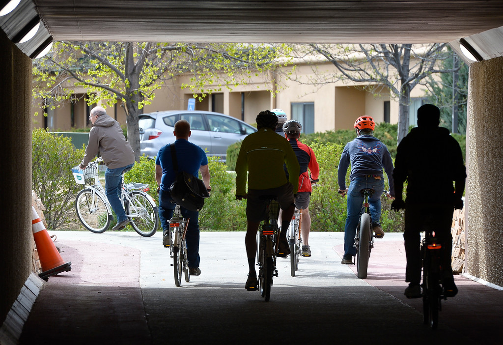 . Cyclists pass through the new underpass during a dedication ceremony for the new Diagonal underpass and Longmont\'s bike share program Thursday. To view a slideshow visit www.timescall.com. Lewis Geyer/Staff Photographer April 20, 2017