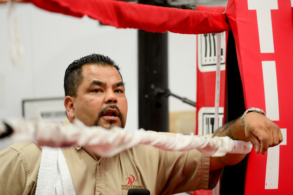 . Coach and Trainer Randy Lopez gives instructions to a boxer in the ring at La Familia boxing at the YMCA in Longmont, Colorado on May 2, 2018. (Photo by Matthew Jonas/Staff Photographer)
