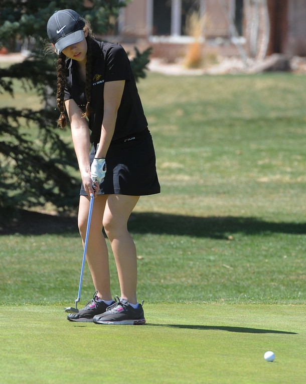 . Thompson Valley\'s Ryanna Burton watches her putt on the 12th green during the Loveland Invitational on Wednesday, April 11, 2018 at the Olde Course at Loveland. (Sean Star/Loveland Reporter-Herald)