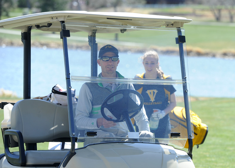 Thompson Valley coach Derek Shagin drives to the ninth green during the Loveland Invitational on Wednesday, April 11, 2018 at the Olde Course at Loveland. (Sean Star/Loveland Reporter-Herald)