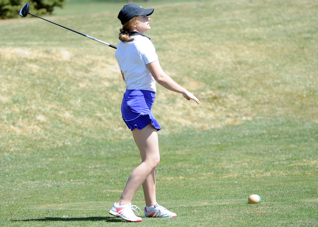 . Mountain View\'s Aly Buckner watches her tee shot on the 13th hole during the Loveland Invitational on Wednesday, April 11, 2018 at the Olde Course at Loveland. (Sean Star/Loveland Reporter-Herald)