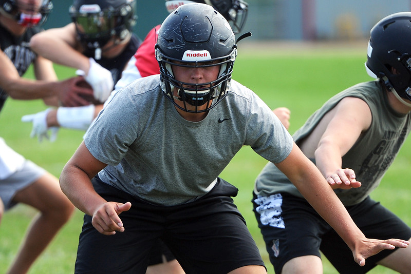 Brenden Bower goes through a play during the Loveland football team's practice Thursday, Aug. 16, 2018 at Loveland High School. (Sean Star/Loveland Reporter-Herald)