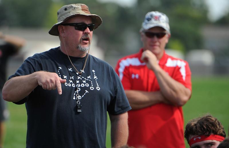 Defensive coordinator Alan Jeffries talks at the end of Loveland football team's practice Thursday, Aug, 16, 2018 at Loveland High School. (Sean Star/Loveland Reporter-Herald)