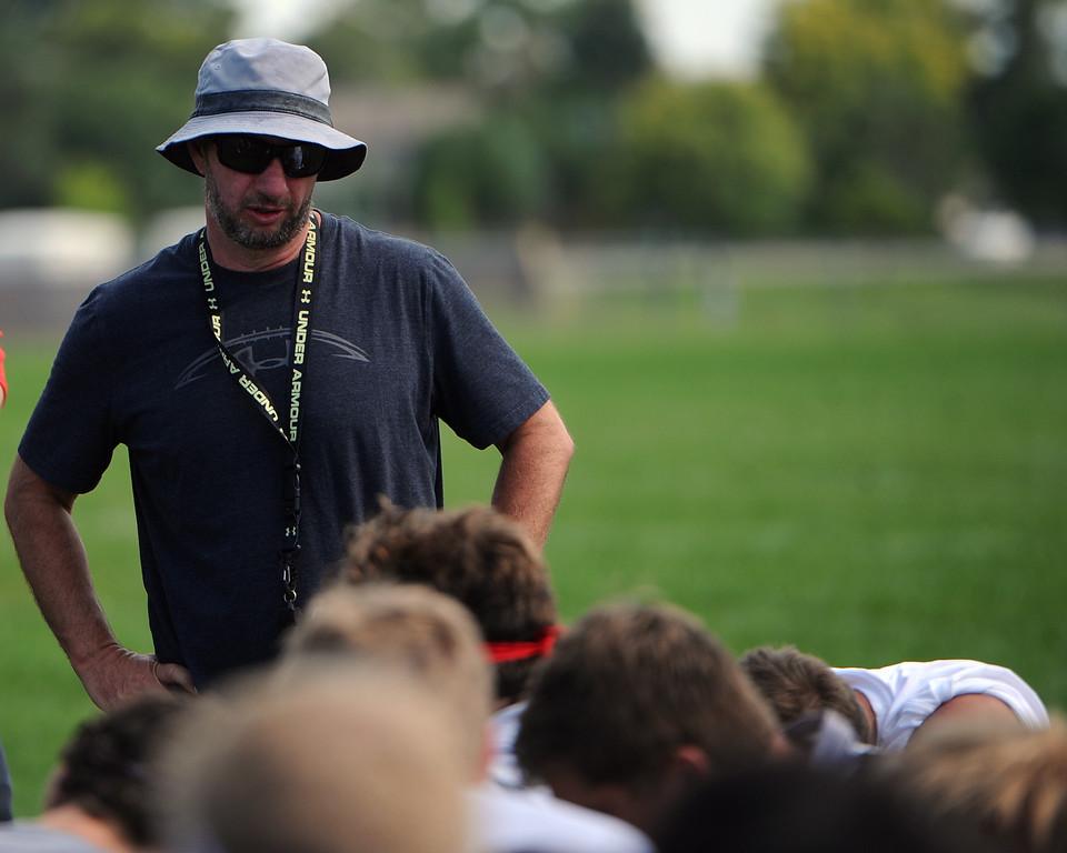 . Assistant coach Robert Mauck talks after the Loveland football team�s practice Thursday, Aug, 16, 2018 at Loveland High School. (Sean Star/Loveland Reporter-Herald)
