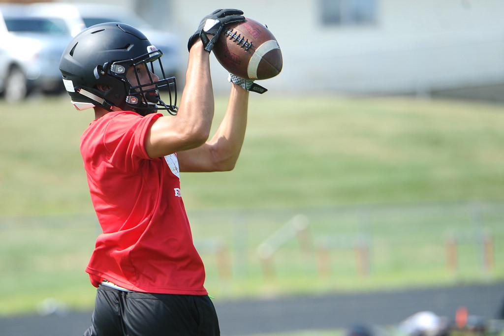 . Isaiah Meyers makes a catch during the Loveland football team�s practice Thursday, Aug. 16, 2018 at Loveland High School. (Sean Star/Loveland Reporter-Herald)