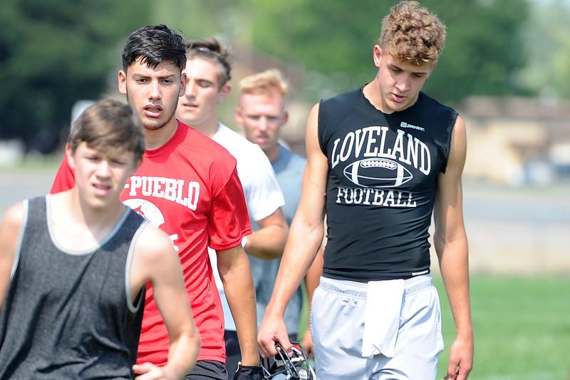 Isaiah Meyers (left) and Riley Kinney take the field for the Loveland football team's practice Thursday, Aug. 16, 2018 at Loveland High School. (Sean Star/Loveland Reporter-Herald)