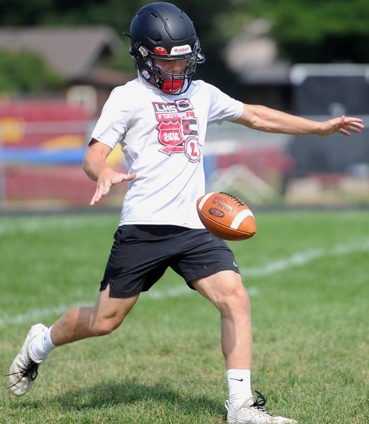 Cody Donovan punts during the Loveland football team's practice Thursday, Aug, 16, 2018 at Loveland High School. (Sean Star/Loveland Reporter-Herald)