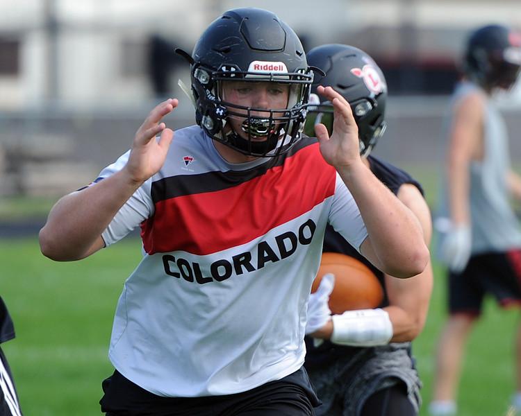 Travis Bretches runs through a play during the Loveland football team's practice Thursday, Aug. 16, 2018 at Loveland High School. (Sean Star/Loveland Reporter-Herald)