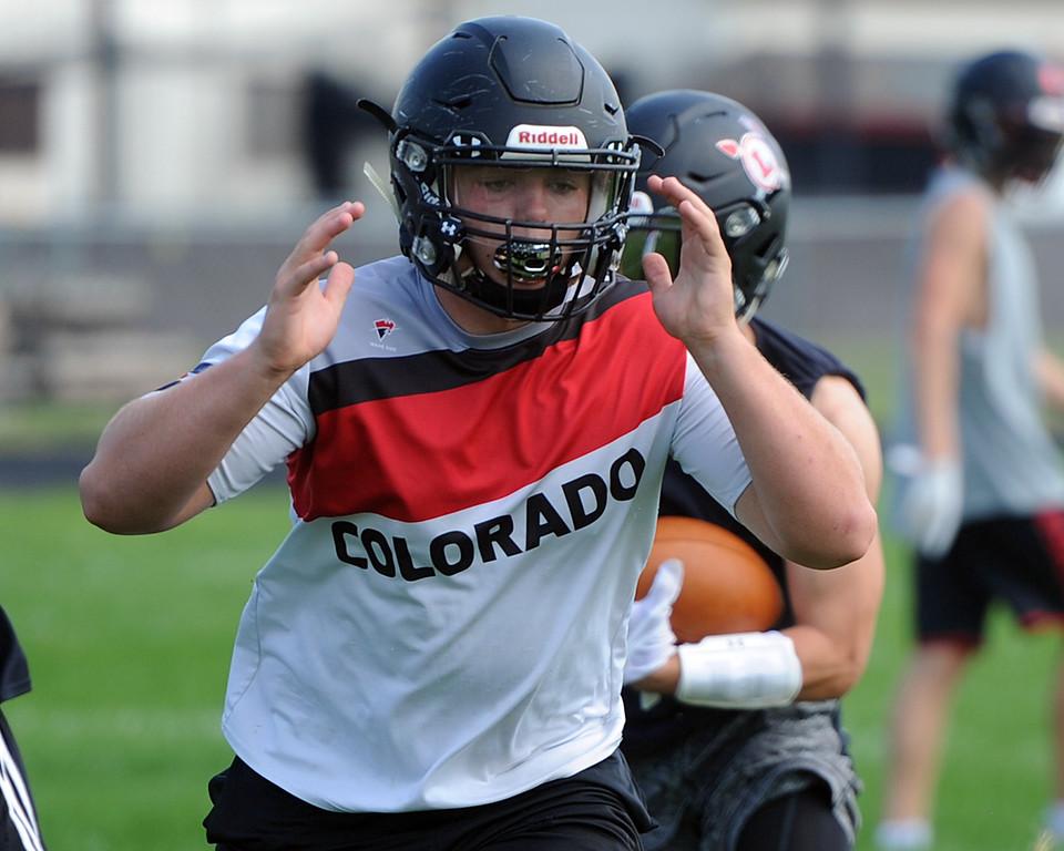 . Travis Bretches runs through a play during the Loveland football team�s practice Thursday, Aug. 16, 2018 at Loveland High School. (Sean Star/Loveland Reporter-Herald)