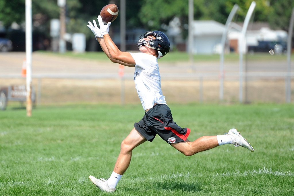 . Caleb Smith reaches for a catch during the Loveland football team�s practice Thursday, Aug. 16, 2018 at Loveland High School. (Sean Star/Loveland Reporter-Herald)