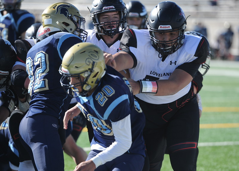 Loveland lineman Jayden Manu blocks a Greeley West defender on Saturday.
