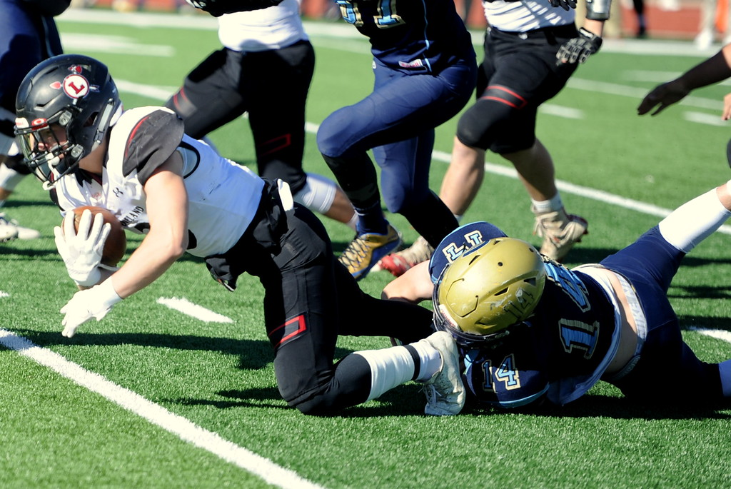 . Loveland\'s Zach Weinmaster finishes a run at Greeley West on Saturday.