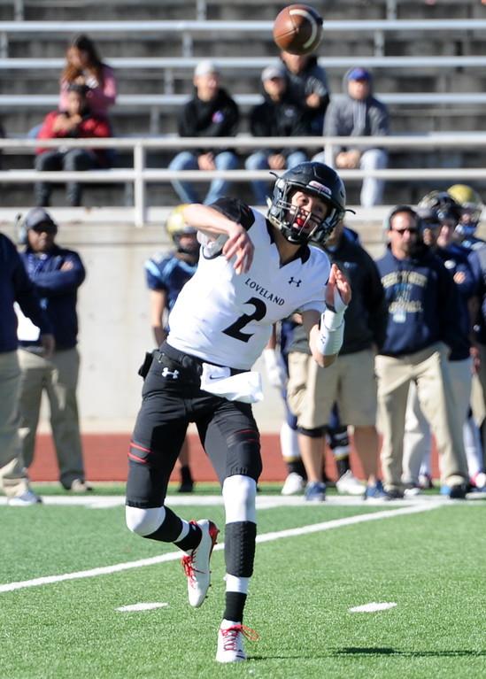 . Loveland quarterback Riley Kinney makes a throw on Saturday at Greeley West.