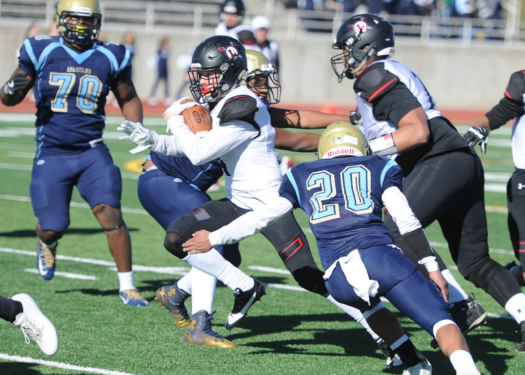. Loveland\'s Cody Rakowsky carries the ball during his team\'s game at Greeley West on Saturday.