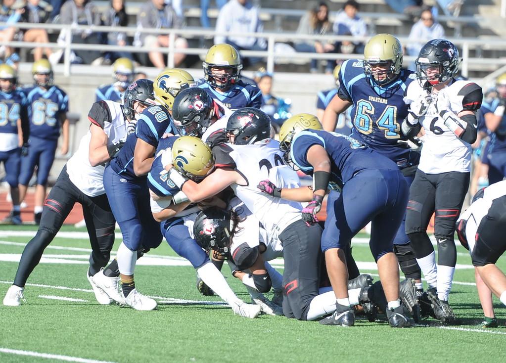 . Loveland\'s defense stuffs a run against Greeley West on Saturday.