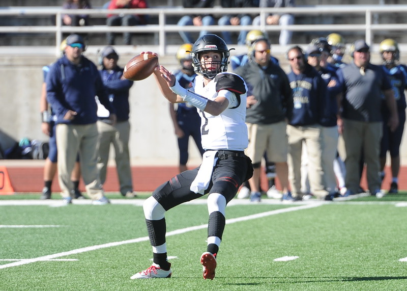Loveland quarterback Riley Kinney reaches back to throw on Saturday at Greeley West.
