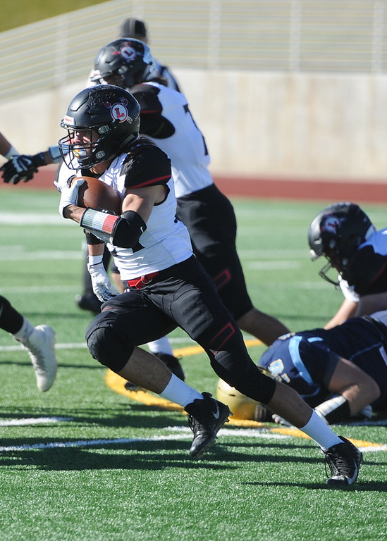. Loveland\'s Trey Cardenas carries the ball against Greeley West on Saturday.