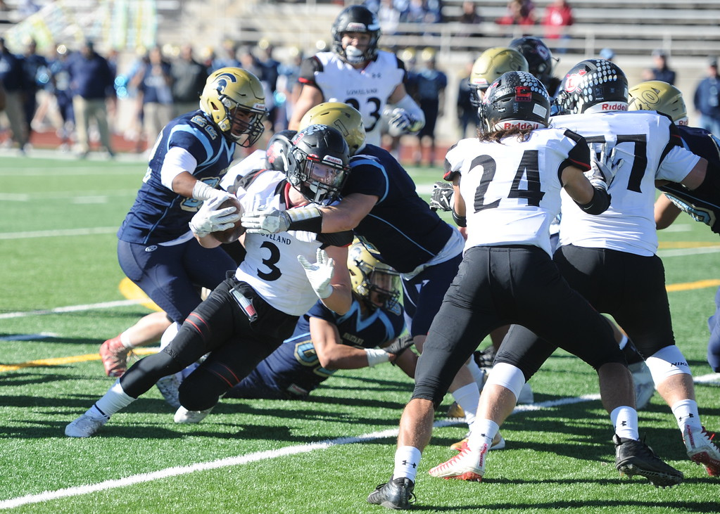 . Loveland\'s Zach Weinmaster tries to break a Greeley West tackle on Saturday at District 6 Stadium in Greeley.