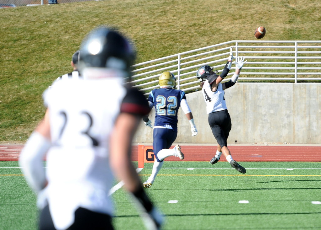 . Loveland\'s Trey Cardenas hauls in a touchdown pass during his team\'s game at Greeley West on Saturday.