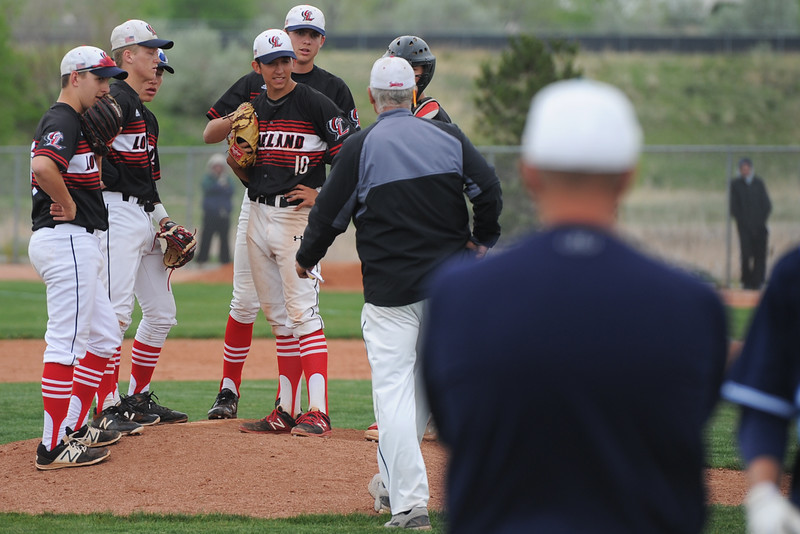 Loveland coach Greg Brock visits the mound during extra innings of the Indians' 5A regional against Ralston Valley on Saturday, May 12, 2018 at Mountain Range High School. (Sean Star/Loveland Reporter-Herald)