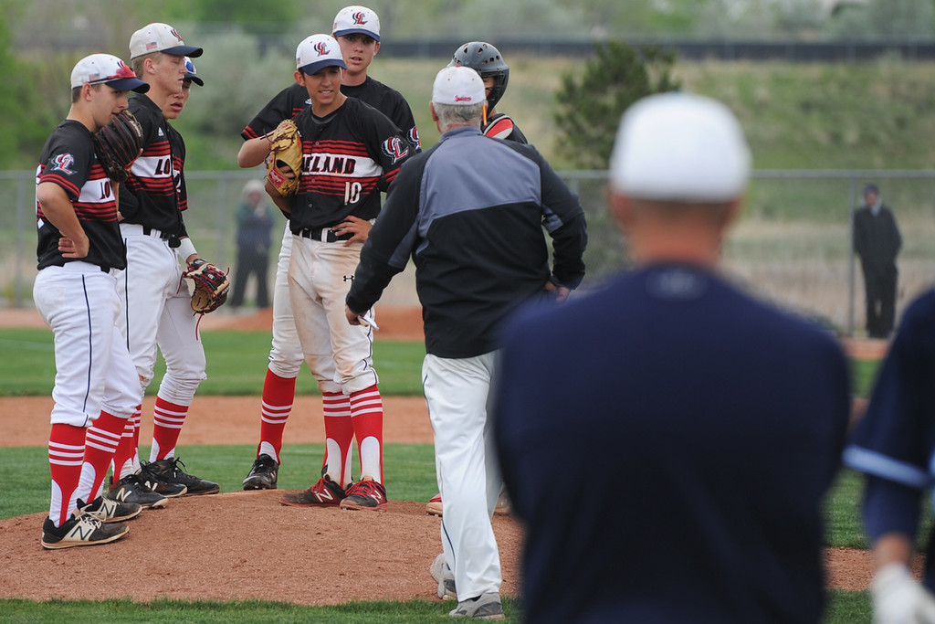 . Loveland coach Greg Brock visits the mound during extra innings of the Indians\' 5A regional against Ralston Valley on Saturday, May 12, 2018 at Mountain Range High School. (Sean Star/Loveland Reporter-Herald)