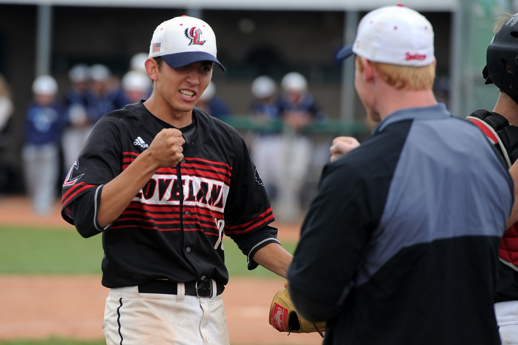 . Loveland pitcher Keegan Villareal fist bumps an LHS assistant coach during the Indians\' 5A regional against Ralston Valley on Saturday, May 12, 2018 at Mountain Range High School. (Sean Star/Loveland Reporter-Herald)