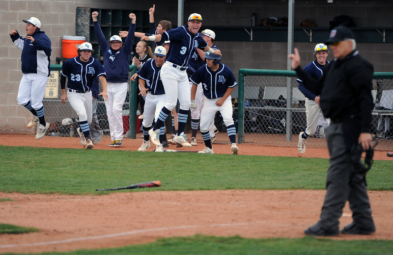 The Ralston Valley dugout erupts in celebration after a walk-off home run by Nik Levensteins in the ninth inning of a 5A regional against Loveland on Saturday, May 12, 2018 at Mountain Range High School. (Sean Star/Loveland Reporter-Herald)