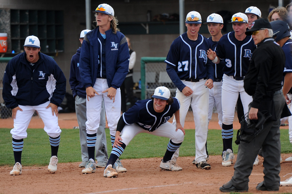 . Ralston Valley waits at home plate after a walk-off home run by Nik Levensteins in the ninth inning of a 5A regional against Loveland on Saturday, May 12, 2018 at Mountain Range High School. (Sean Star/Loveland Reporter-Herald)
