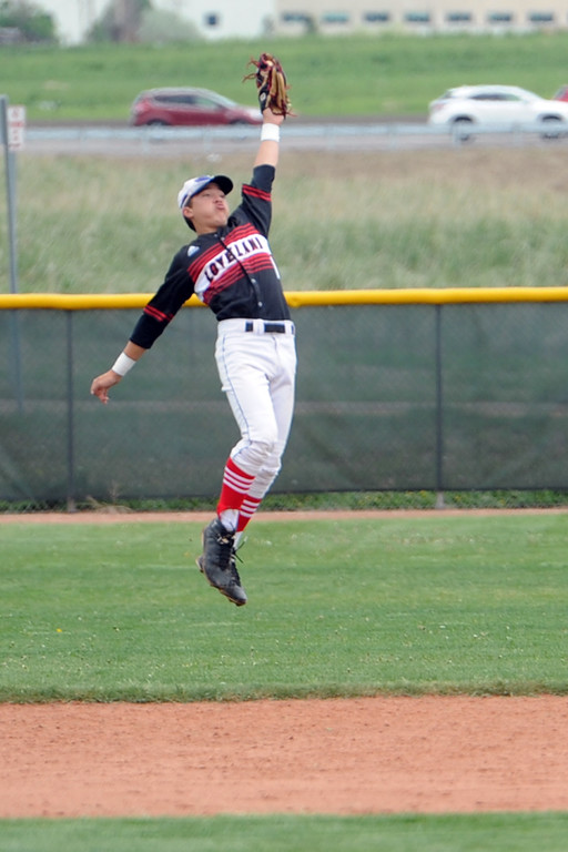 . Loveland second baseman Jaxon Cabrera leaps to snag a line drive during the Indians\' 5A regional against Ralston Valley on Saturday, May 12, 2018 at Mountain Range High School. (Sean Star/Loveland Reporter-Herald)
