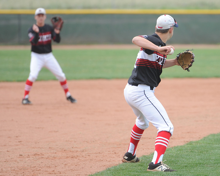 Loveland third baseman Jackson Bakovich throws around the horn to shortstop Tyler Hamill during a 5A regional against Ralston Valley on Saturday, May 12, 2018 at Mountain Range High School. (Sean Star/Loveland Reporter-Herald)
