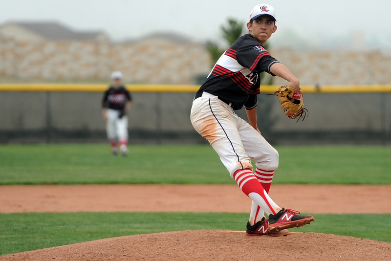 Loveland's Keegan Villareal delivers a pitch during a 5A regional against Ralston Valley on Saturday, May 12, 2018 at Mountain Range High School. (Sean Star/Loveland Reporter-Herald)