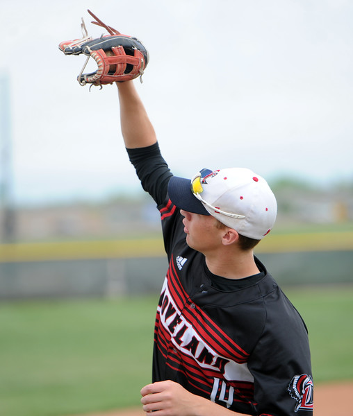Loveland's Heron Lenze reaches for a catch between innings during a 5A regional against Ralston Valley on Saturday, May 12, 2018 at Mountain Range High School. (Sean Star/Loveland Reporter-Herald)