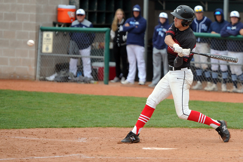 Loveland's Zach Harstad takes a swing during a 5A regional against Ralston Valley on Saturday, May 12, 2018 at Mountain Range High School. (Sean Star/Loveland Reporter-Herald)