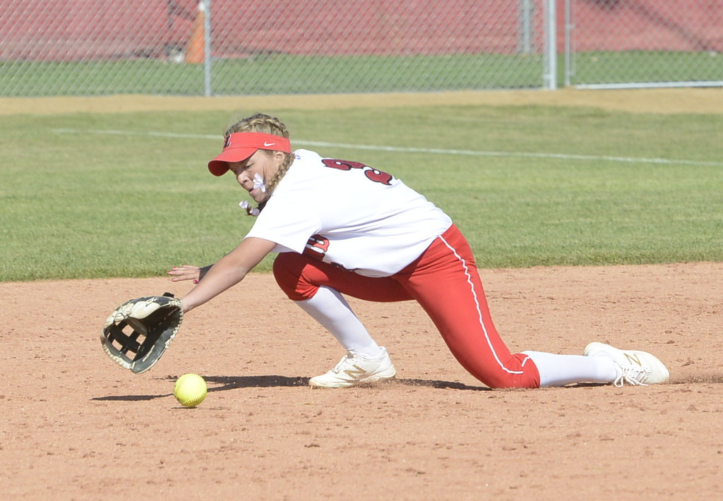. Loveland second baseman Ryley Long reaches for a grounder at Saturday at Brighton.