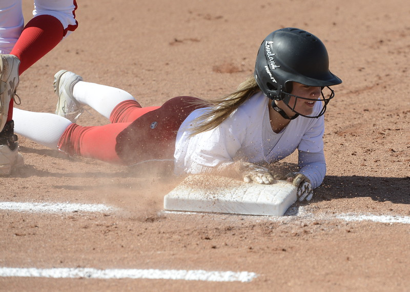 Bri Mowry slides safely back to first on Saturday against Brighton.